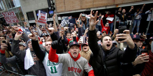 Boston Red Sox fans cheer during a parade to celebrate the team's World Series championship over the Los Angeles Dodgers on Wednesday, Oct. 31, in Boston.