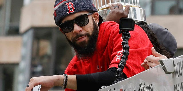 The World Series trophy was damaged slightly after someone at the Red Sox parade in Boston threw a beer can at it.