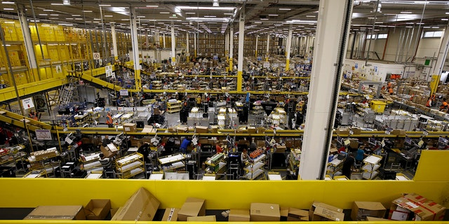 Workers sort products at an Amazon Fulfilment Center in Wroclaw, Poland December 3, 2015, during the busy holiday shopping season. (REUTERS/Kacper Pempel)