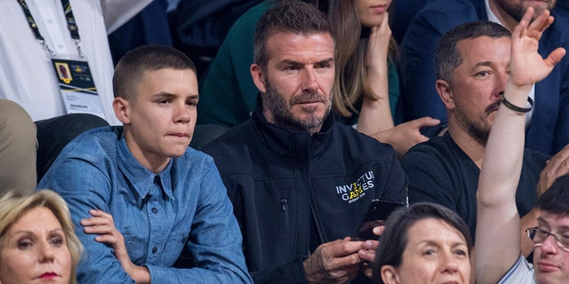 Former England footballer David Beckham and his son Romeo watch the wheelchair basketball final at The Invictus Games in Sydney, Australia, Saturday, Oct. 27, 2018. Prince Harry and his wife Meghan are on day twelve of their 16-day tour of Australia and the South Pacific. (AP Photo)