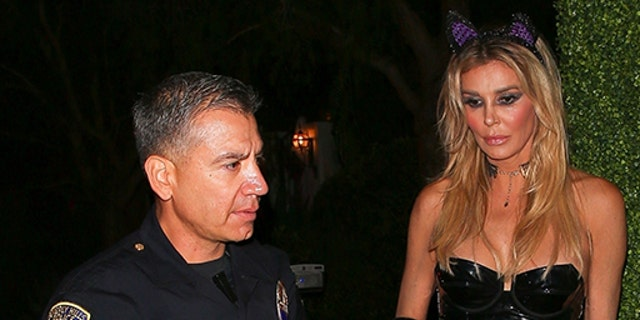 Beverly Hills, CA - Brandi Glanville was accused of assaulting a person inside the Casamigos Party. Pictured here a man with a bag of ice on his face chatting with the police. Pictured: Brandi Glanville BACKGRID USA 27 OCTOBER 2018 USA: +1 310 798 9111 / usasales@backgrid.com UK: +44 208 344 2007 / uksales@backgrid.com *UK Clients - Pictures Containing Children Please Pixelate Face Prior To Publication*