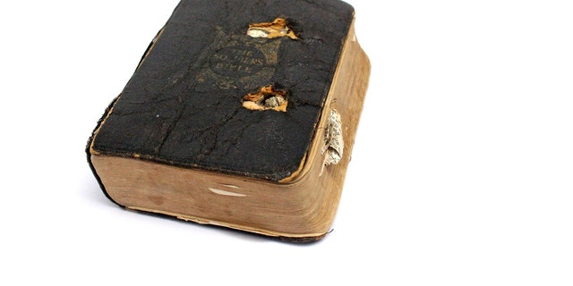 Private Leslie Friston's bullet-scarred Bible, which he brought with him when World War I ended.