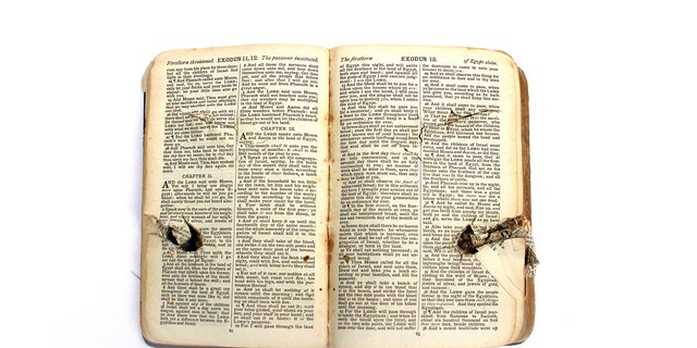 The Bible was damaged when a German plane machine-gunned a makeshift hospital.