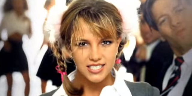"""Britney Spears celebrated the 20th anniversary of her debut single """"...Baby One More Time"""" on Tuesday. The singer is pictured here in the music video for her hit, which was released in 1998."""