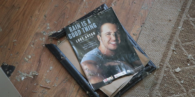 A framed photo of Luke Bryan reportedly damaged at his mom's house from Hurricane Michael.