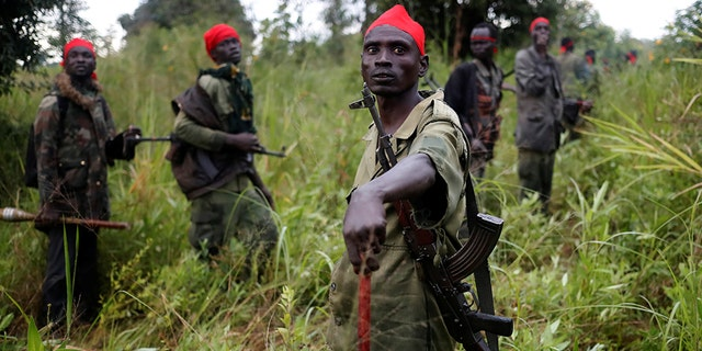SPLA-IO (SPLA-In Opposition) rebels stand after an assault on government SPLA (Sudan People's Liberation Army) soldiers, outside the town of Kaya, on the border with Uganda, South Sudan, August 26, 2017. REUTERS/Goran Tomasevic