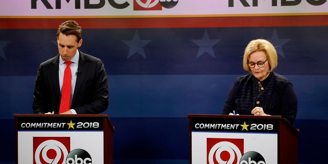 FILE - Missouri U.S. Senate candidates incumbent Democratic Sen. Claire McCaskill, right, and Republican challenger Josh Hawley look over their notes before the start of a debate.
