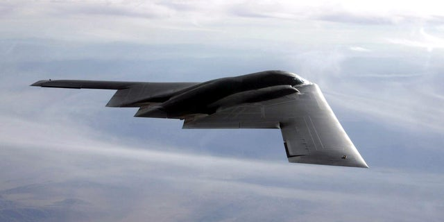 The B-2 flies over the Utah Testing and Training Range at Hill Air Force Base, Utah, during the test run Sept. 10, in which the B-2 dropped 80 inert Joint Direct Attack Munitions. (U.S. Air Force photo by Bobbie Garcia)