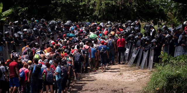 The group of Central American migrants were met by Mexican Federal Police. (AP Photo/Santiago Billy)