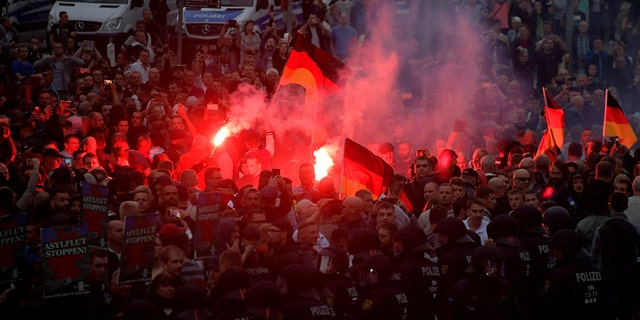 Right-wing supporters protest after a German man was stabbed last weekend in Chemnitz, Germany, August 27