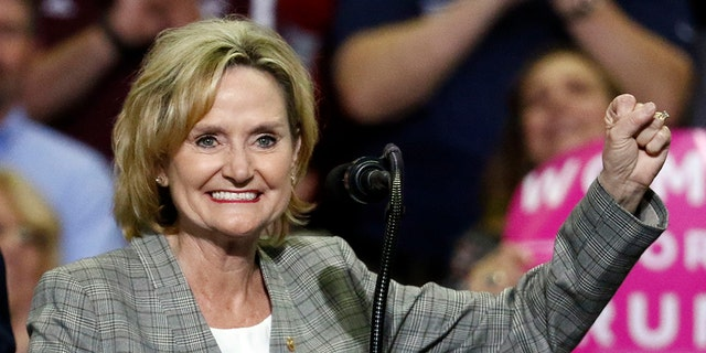 FILE - In this Oct. 2, 2018 photograph, U.S. Sen. Cindy Hyde-Smith, R-Miss., encourages the crowd at a rally in Southaven, Miss. (AP Photo/Rogelio V. Solis, File)