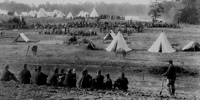 File photo - Confederate prisoners under guard during the Civil War