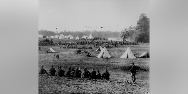 File photo - Confederate prisoners under guard during the Civil War