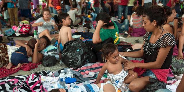 A group of migrants rests at the central park in Ciudad Hidalgo, Mexico.