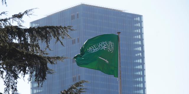Saudi Arabia's flag flies atop the country's consulate in Istanbul, Friday, Oct. 26, 2018. The Saudi officials who killed journalist Jamal Khashoggi in their Istanbul consulate must reveal the location of his body, Turkey's President Recep Tayyip Erdogan said Friday in remarks that were sharply critical of the kingdom's handling of the case.(AP Photo/Lefteris Pitarakis)