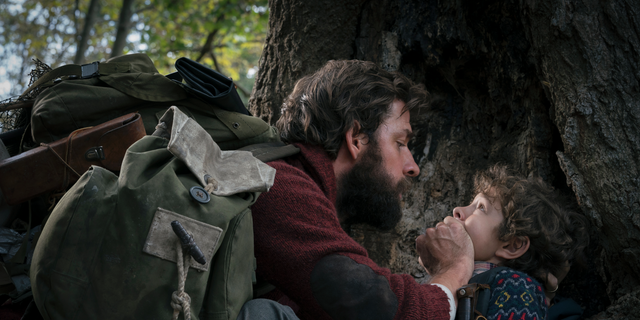 "John Krasinski, left, and Noah Jupe are seen in a scene from ""A Quiet Place."""