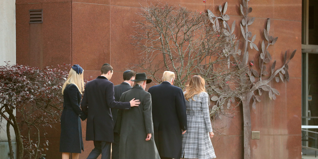 President Donald Trump and first lady Melania Trump walk into Pittsburgh's Tree of Life Synagogue in Pittsburgh, Tuesday, Oct. 30, 2018, with Ivanka Trump, back left, and Jared Kushner and Tree of Life Rabbi Jeffrey Myers, back right, and Ron Dermer, Israel's ambassador to the United States. (AP Photo/Andrew Harnik)
