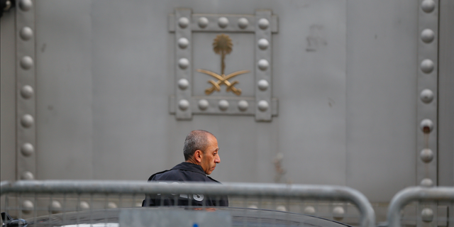 A Turkish police officer patrols outside the Saudi Arabia consulate in Istanbul.