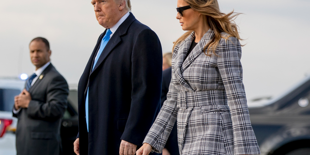 President Donald Trump and first lady Melania Trump arrive at Pittsburgh International Airport in Coraopolis, Pa., Tuesday, Oct. 30, 2018, following last weekends shooting at Tree of Life Synagogue in Pittsburgh. (AP Photo/Andrew Harnik)