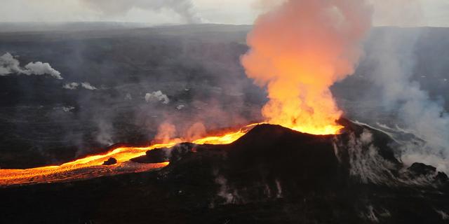 Lava from Kilauea volcano erupts in the Leilani Estates neighborhood near Pahoa, Hawaii, on July 14, 2018.(U.S. Geological Survey via AP)