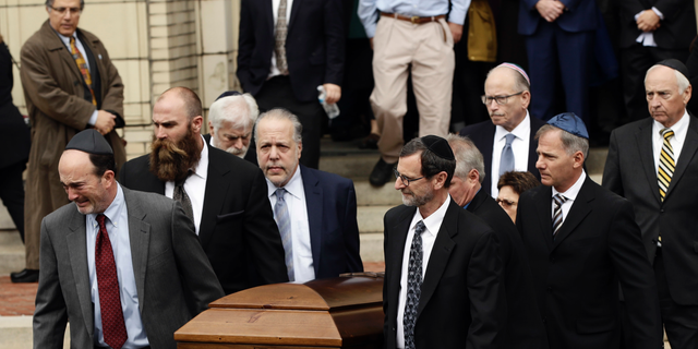 A casket is carried out of Rodef Shalom Congregation after the funeral services for brothers Cecil and David Rosenthal, Tuesday, Oct. 30, in Pittsburgh. The brothers were killed in the mass shooting last week.
