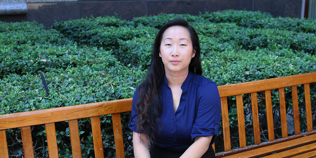 FILE - In this Aug. 12, 2016, file photo, Yee Xiong sits for a photo in Sacramento, Calif. A jury has awarded more than $150,000 in damages to the California woman whose 2012 campus assault case drew wide attention. Now 26 years old, Xiong calls the verdict a 'huge win' for survivors around the world and shows that people can be held accountable, not matter how long it takes. (AP Photo/Darcy Costello, File)