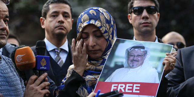 Holding a picture of missing Saudi writer Jamal Khashoggi, Tawakkol Karman, of Yemen the Nobel Peace Prize laureate for 2011, talks to members of the media near the Saudi Arabia consulate in Istanbul, Friday, Oct. 5, 2018.
