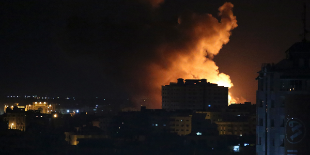 Smoke rises from an explosion caused by an Israeli airstrike on Gaza City last month (AP Photo/Adel Hana)