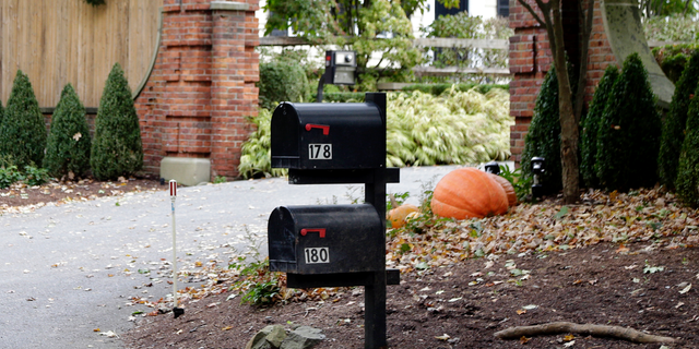 """Mailboxes stand outside the entrance to a house owned by philanthropist George Soros in Katonah, N.Y., a suburb of New York City, Tuesday, Oct. 23, 2018. A device found outside the compound """"had the components"""" of a bomb, including explosive powder, a law enforcement official said Tuesday."""