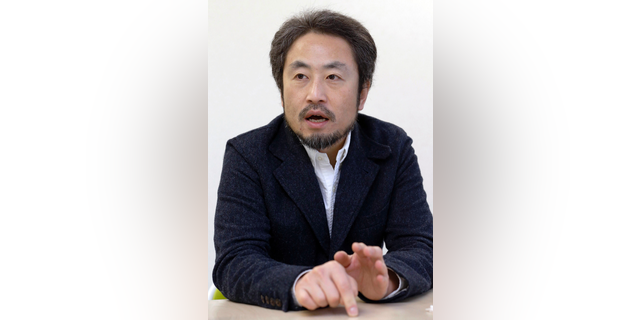 In this photo taken on Feb. 18, 2015, Japanese freelance journalist Jumpei Yasuda speaks during an interview in Tokyo. Japan's government says a man believed to be a Japanese freelance journalist who went missing three years ago while in Syria has been released and is now in Turkey. Chief Cabinet Secretary Yoshihide Suga told a news conference late Tuesday, Oct. 23, 2018 that Japan was informed by Qatar that the man, believed to be Jumpei Yasuda, has been released. (Kyodo News via AP)