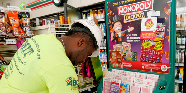 Jean Pierre fills out several Mega Millions lottery tickets for purchase at a convenience store Monday, Oct. 22, 2018, in Orlando, Fla. The top prize for Tuesday night's Mega Millions drawing would be the largest lottery jackpot in U.S. history. (AP Photo/John Raoux)