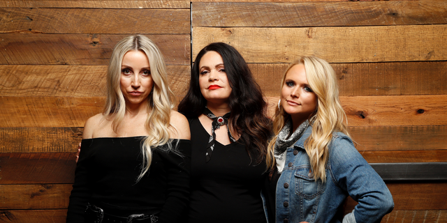 """In this Oct. 1, 2018 photo, Ashley Monroe, from left, Angaleena Presley and Miranda Lambert of the Pistol Annies pose for a photo at Sony Nashville in Nashville, Tenn., to promote their newest album, """"Interstate Gospel,"""" out on Friday."""