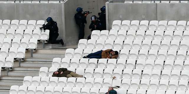 Members of the National Gendarmerie Intervention Group (GIGN), Recherche Assistance Intervention Dissuasion (RAID) and Research and Intervention Brigades (BRI) attend a training exercise in case of terrorist attack at the G6 Interior Ministers' meeting at the Groupama stadium in Decines, near Lyon, central France, Tuesday, Oct. 9, 2018. (AP Photo/Christophe Ena)