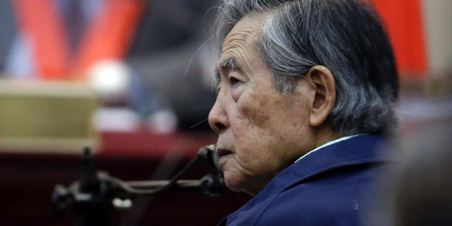 In this March 15, 2018 file photo, Peru's former President Alberto Fujimori listens to a question during his testimony in a courtroom at a military base in Callao, Peru. (AP Photo/Martin Mejia, File)