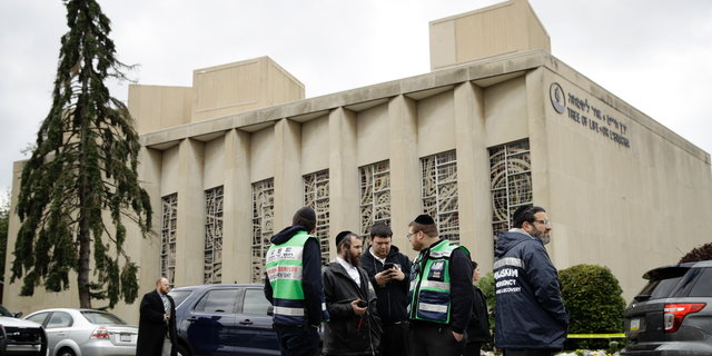 Personnel from Chesed Shel Emes Emergency Services and Recovery Unit gather near the Tree of Life Synagogue in Pittsburgh, Sunday, Oct. 28, 2018. Robert Bowers, the suspect in the mass shooting at the synagogue, expressed hatred of Jews during the rampage and told officers afterward that Jews were committing genocide and he wanted them all to die, according to charging documents made public Sunday. (AP Photo/Matt Rourke)