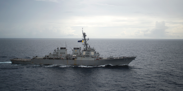 In this Oct. 13, 2016, photo provided by the U.S. Navy, guided-missile destroyer USS Decatur operates in the South China Sea as part of the Bonhomme Richard Expeditionary Strike Group.