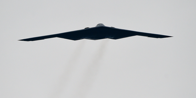 FILE - In this Oct. 25, 2015, file photo, a U.S. Air Force B2 Spirit stealth bomber performs a flyover at the Talladega Superspeedway in Talladega, Ala. The Air Force says a Missouri-based B2 landed in Colorado Springs, Colo., on Tuesday, Oct. 23, 2018, after an unspecified emergency. Neither of the pilots was injured. (AP Photo/Mark Almond, File)
