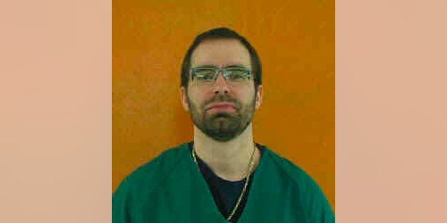 This undated file photo provided by the Ohio Department of Rehabilitation and Correction shows Greg Reinke. Prosecutors have charged two prison inmates, Reinke and Casey Pigge, in separate knife attacks at an Ohio prison that left a guard severely wounded and injured four prisoners unable to defend themselves because they were handcuffed to a table. (Ohio Department of Rehabilitation and Correction via AP)