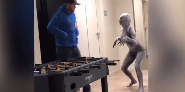 In the footage, Martinez sports a silver-colored, skeletal bodysuit — complete with a spooky mask and extra-long fingers — that zips to conceal her entire frame, as she prances around and scares passersby in the lobby of an apartment buildingat her college.