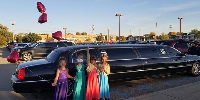 Aliyah Culbert, Hailey Culbert, Alivia Reece and Avery Recee in front of the limousine.