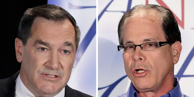 FILE - This combination of Oct. 8, 2018, file photos show Indiana U.S. Senate candidates, Democratic Sen. Joe Donnelly, left, and former Republican state Rep. Mike Braun during a debate in Westville, Ind. (AP Photo/Darron Cummings, File)