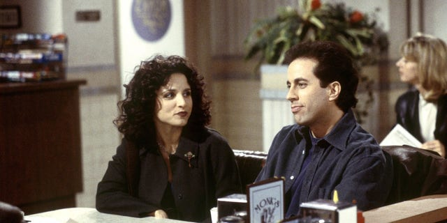 "Julia Louis-Dreyfus, left, as Elaine Benes and Jerry Seinfeld, right, as himself on ""Seinfeld."""