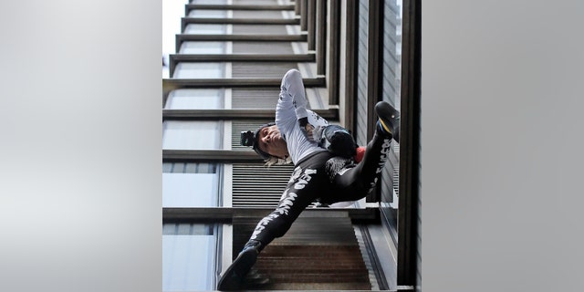 Urban climber dubbed the French Spiderman, Alain Robert scales the outside of Heron Tower building in the City of London.