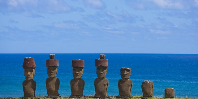 File photo - Statues at Anakena Beach, Easter Island, Chile. (Photo by Eric LAFFORGUE/Gamma-Rapho via Getty Images)
