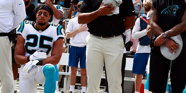 Carolina Panthers' Eric Reid (25) kneels during the national anthem before an NFL football game against the New York Giants in Charlotte, N.C., Sunday, Oct. 7, 2018. (AP Photo/Jason E. Miczek)