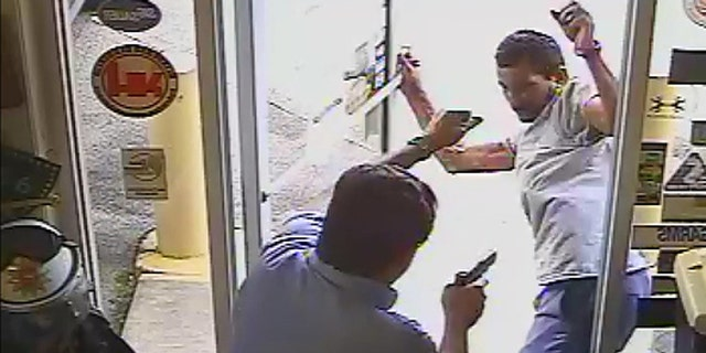 The moment before Lakeland Commissioner Michael Dunn opens fire on Cristobal Lopez, who he confronted for allegedly stealing a hatchet from his store.