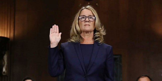 Christine Blasey Ford is sworn in before the Senate Judiciary Committee on Capitol Hill in Washington on Thursday, Sept. 27, 2018.