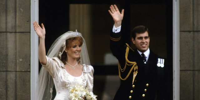 Sarah Ferguson, Duchess of York and Prince Andrew, Duke of York stand on the balcony of Buckingham Palace and wave at their wedding on July 23, 1986 in London, England.