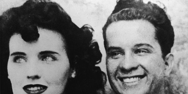 Photograph probably taken in a photo booth of American aspiring actress and murder victim Elizabeth Short (1924 - 1947), known as the 'Black Dahlia,' and an unidentified man, mid-1940s. Some experts believe this man to be a suspect in the still unsolved murder. Getty.