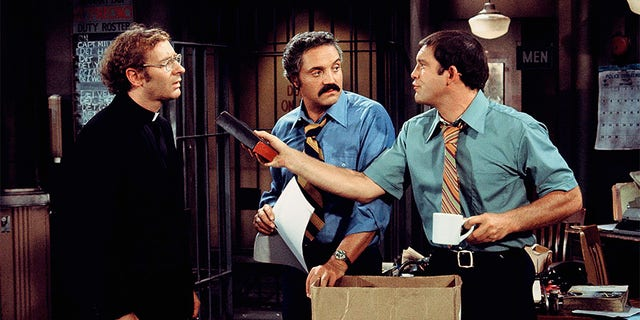 Hal Linden (center) starred as Barney Miller.